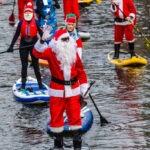 Santa paddleboarding